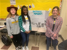 Ninth grade students host a farmer's market to explain types of agriculture to their peers